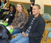 Audience members listen to the keynote speaker.