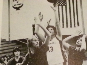 A yearbook photo of me shooting a basketball my senior year.