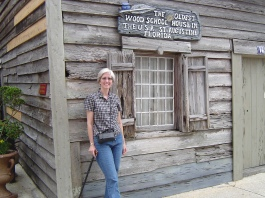 The author with cane posed before the oldest school house located in St. Augustine.