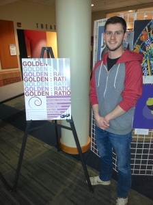 Brandon Bisch stands next to the Golden Ratio Poster that Michael Biglands and he created.
