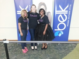 Students from FADS pose before the Belk's sign.