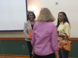 Ms. Welfare talks with women after her speech.